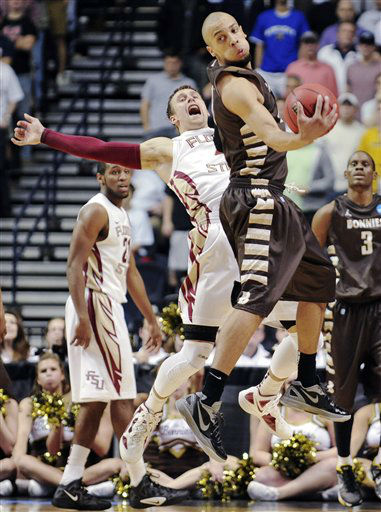 St. Bonaventure forward Demitrius Conger, front, grabs a pass in front of Florida State guard Deividas Dulkys, second from left, in the second half of a second-round NCAA college basketball tournament game on Friday, March 16, 2012, in Nashville, Tenn. Florida State won 66-63.  <span class=meta>(AP Photo&#47; Donn Jones)</span>