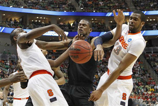 "<div class=""meta ""><span class=""caption-text "">Kansas State's Jordan Henriquez, center, loses the ball as Syracuse's C.J. Fair, left, and James Southerland (43) defend in the second half of an NCAA tournament third-round college basketball game on Saturday, March 17, 2012 in Pittsburgh. Syracuse won 75-59.  (AP Photo/ Keith Srakocic)</span></div>"