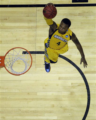 Marquette guard Todd Mayo &#40;4&#41; shoots in the second half of their NCAA tournament second-round college basketball game against BYU in Louisville, Ky., Thursday, March 15, 2012. Marquette beat BYU 88-68.  <span class=meta>(AP Photo&#47; Dave Martin)</span>