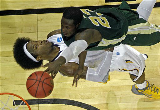 Murray State forward Edward Daniel &#40;2&#41; takes a charge from Colorado State forward Will Bell &#40;23&#41; in the second half of their NCAA tournament second-round college basketball game in Louisville, Ky., Thursday, March 15, 2012.  <span class=meta>(AP Photo&#47; Dave Martin)</span>