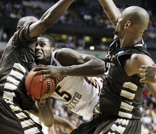 "<div class=""meta ""><span class=""caption-text "">Florida State forward Bernard James (5) gets caught between St. Bonaventure defenders Youssou Ndoye, left, and Da'Quan Cook, right, in the first half of a second-round NCAA college basketball tournament game on Friday, March 16, 2012, in Nashville, Tenn.  (AP Photo/ Mark Humphrey)</span></div>"