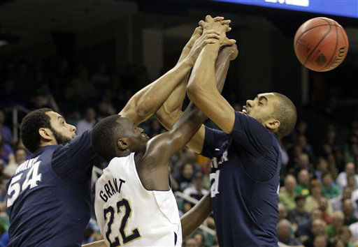 Notre Dame&#39;s Jerian Grant &#40;22&#41;, Xavier&#39;s Andre Walker &#40;54&#41; and Xavier&#39;s Jeff Robinson &#40;21&#41; battle for a rebound during the first half of an NCAA tournament second-round college basketball game in Greensboro, N.C., Friday, March 16, 2012.  <span class=meta>(AP Photo&#47; Chuck Burton)</span>