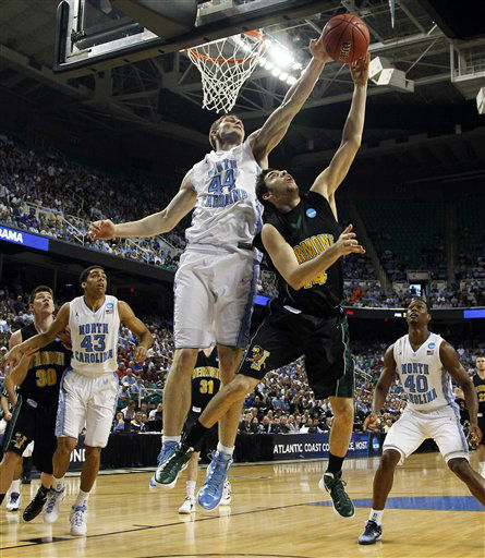 North Carolina&#39;s Tyler Zeller &#40;44&#41; blocks a shot by Vermont&#39;s Pat Bergmann &#40;30&#41; during the first half of an NCAA tournament second-round college basketball game in Greensboro, N.C., Friday, March 16, 2012. North Carolina won 77-58.  <span class=meta>(AP Photo&#47; Gerry Broome)</span>