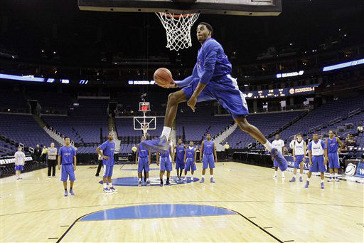 Memphis&#39; D.J. Stephens dunks during practice, Thursday, March 15, 2012, in Columbus, Ohio. Memphis is scheduled to play St. Louis in the second round of the NCAA college basketball tournament on Friday. <span class=meta>(AP Photo&#47; Tony Dejak)</span>