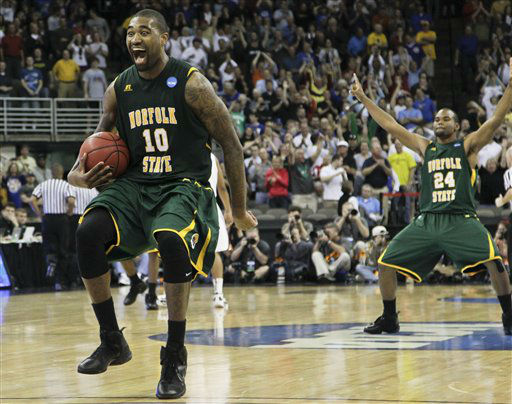 Norfolk State&#39;s Kyle O&#39;Quinn &#40;10&#41; and Brandon Wheeless, right, celebrate after defeating Missouri 86-84 in an NCAA tournament second-round college basketball game at CenturyLink Center in Omaha, Neb., Friday, March 16, 2012.  <span class=meta>(AP Photo&#47; Orlin Wagner)</span>