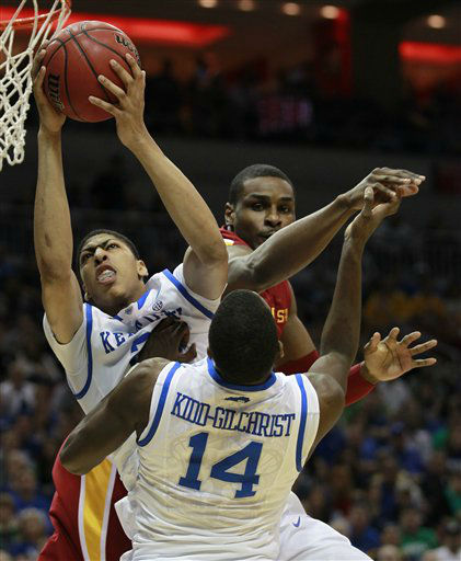 Kentucky forward Anthony Davis &#40;23&#41; pulls down a rebound as he battles Iowa State forward Anthony Booker, rear, in the first half of their NCAA third-round tournament college basketball game in Louisville, Ky., Saturday, March 17, 2012.  At front is Kentucky forward Michael Kidd-Gilchrist &#40;14&#41;.  <span class=meta>(AP Photo&#47; John Bazemore)</span>