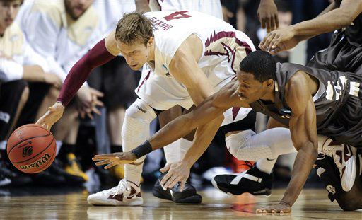 Florida State guard Deividas Dulkys, left, chases down the ball with St. Bonaventure guard Charlon Kloof, right, in the first half of a second-round NCAA college basketball tournament game on Friday, March 16, 2012, in Nashville, Tenn.  <span class=meta>(AP Photo&#47; Donn Jones)</span>