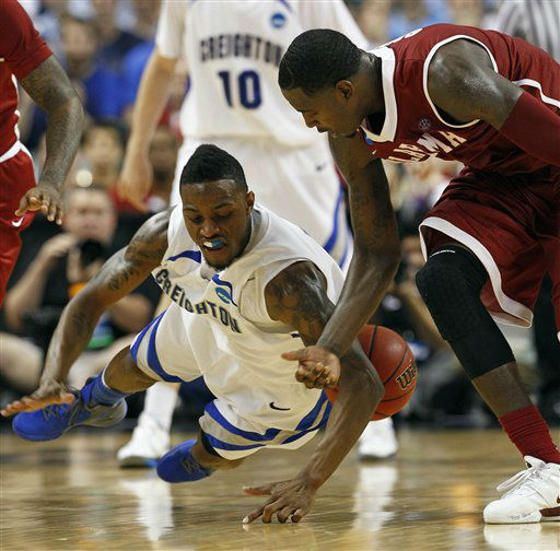 Creighton&#39;s Josh Jones goes to the floor as he battles for the ball with Alabama&#39;s JaMychal Green, right, A during the second half of a Midwest Regional NCAA tournament second-round college basketball game in Greensboro, N.C., Friday, March 16, 2012. Creighton won 58-57.  <span class=meta>(AP Photo&#47; Gerry Broome)</span>