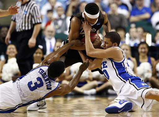 Duke&#39;s Tyler Thornton &#40;3&#41; and Seth Curry, right, struggle with Lehigh&#39;s Mackey McKnight, center, during the first half of an NCAA tournament second-round college basketball game in Greensboro, N.C., Friday, March 16, 2012.  <span class=meta>(AP Photo&#47; Gerry Broome)</span>