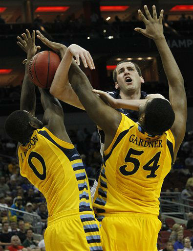 "<div class=""meta ""><span class=""caption-text "">Marquette forward Davante Gardner (54) and Marquette forward Jamil Wilson (0) block the shot of BYU forward Noah Hartsock (34) in the second half of an NCAA tournament second-round college basketball game in Louisville, Ky., Thursday, March 15, 2012.  (AP Photo/ Dave Martin)</span></div>"