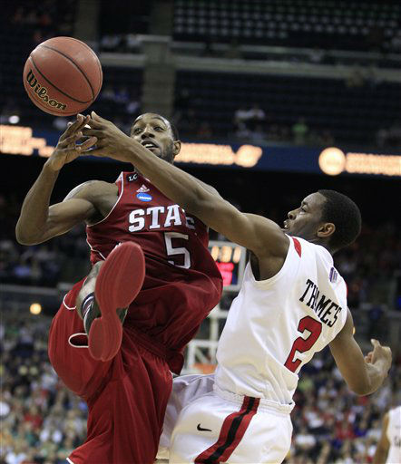 North Carolina State&#39;s C.J. Leslie &#40;5&#41; and San Diego State&#39;s Xavier Thames &#40;2&#41; battle for a loose ball during the second half of an NCAA men&#39;s college basketball tournament second-round game  in Columbus, Ohio, Friday, March 16, 2012. North Carolina State won 79-65. <span class=meta>(AP Photo&#47; Tony Dejak)</span>