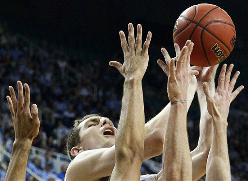 "<div class=""meta ""><span class=""caption-text "">North Carolina's Tyler Zeller shoots over Vermont defenders during the first half of an NCAA tournament second-round college basketball game in Greensboro, N.C., Friday, March 16, 2012. (AP Photo/ Gerry Broome)</span></div>"