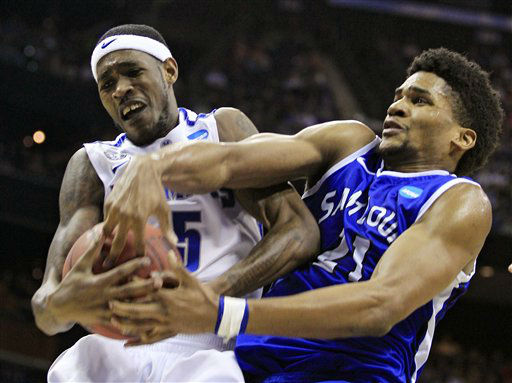 Memphis&#39; Will Barton, left, is fouled by Saint Louis&#39; Dwayne Evans during the second half of an NCAA men&#39;s college basketball tournament second-round game in Columbus, Ohio, Friday, March 16, 2012. St Louis won 61-54.  <span class=meta>(AP Photo&#47; Tony Dejak)</span>