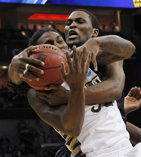 Marquette forward Jae Crowder, front, battles Murray State forward Ivan Aska &#40;42&#41; for a rebound in the first half of their NCAA third-round tournament college basketball game in Louisville, Ky., Saturday, March 17, 2012.  <span class=meta>(AP Photo&#47; Dave Martin)</span>