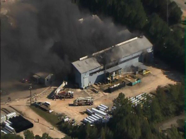 Fire burns at Contech Construction Products at Edwards Mill and Chapel Hill roads in Raleigh. <span class=meta>(WTVD Photo)</span>