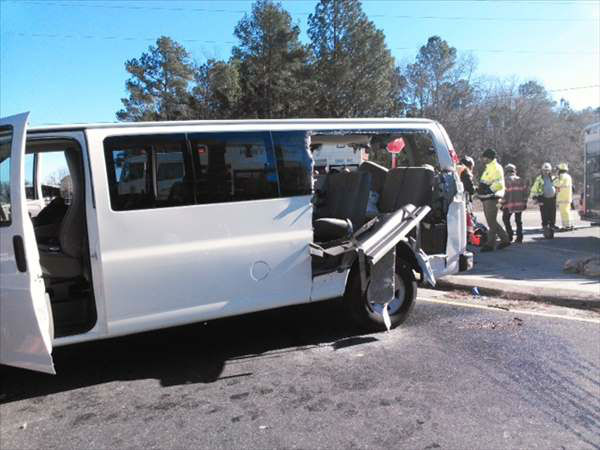 "<div class=""meta ""><span class=""caption-text "">Ten members of a Fort Bragg honor guard on their way to a Charlotte-area funeral were hurt Friday in a crash outside Laurinburg. (WTVD Photo/ Tim Poole, Larry Poole's Wrecker Service)</span></div>"