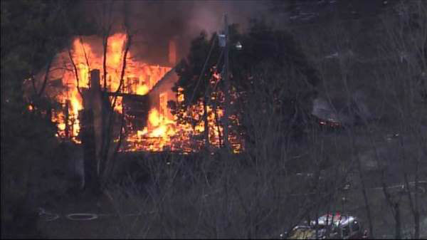 Fire crews rushed to the scene of a fully-engulfed home near Carrboro Friday afternoon. <span class=meta>(WTVD Photo)</span>