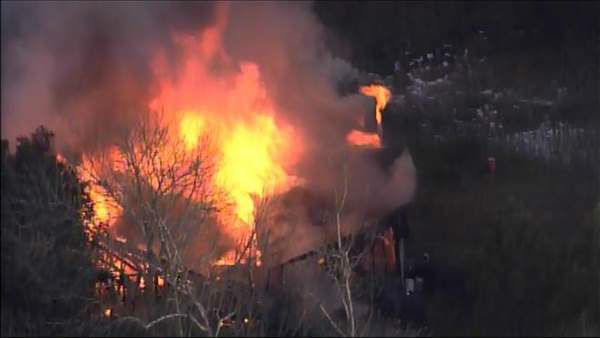 "<div class=""meta ""><span class=""caption-text "">Fire crews rushed to the scene of a fully-engulfed home near Carrboro Friday afternoon. (WTVD Photo)</span></div>"