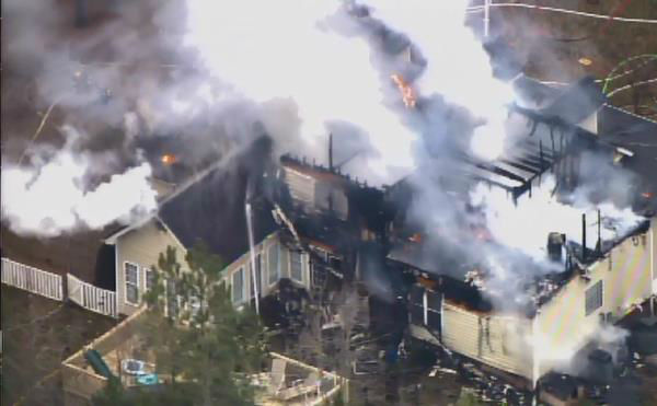 "<div class=""meta ""><span class=""caption-text "">Fire swept through a home in the 3000 block of Shepard School Road in Zebulon Tuesday afternoon. (WTVD Photo)</span></div>"