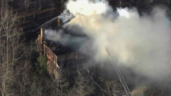 "<div class=""meta image-caption""><div class=""origin-logo origin-image ""><span></span></div><span class=""caption-text"">Crews battled a fire at a home near the Treyburn Country Club area of Durham. (WTVD Photo)</span></div>"