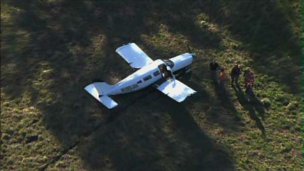 Police and rescue crews were called to a small plane crash in Sanford Wednesday afternoon near the Sanford-Lee County Regional Airport. <span class=meta>(WTVD Photo)</span>