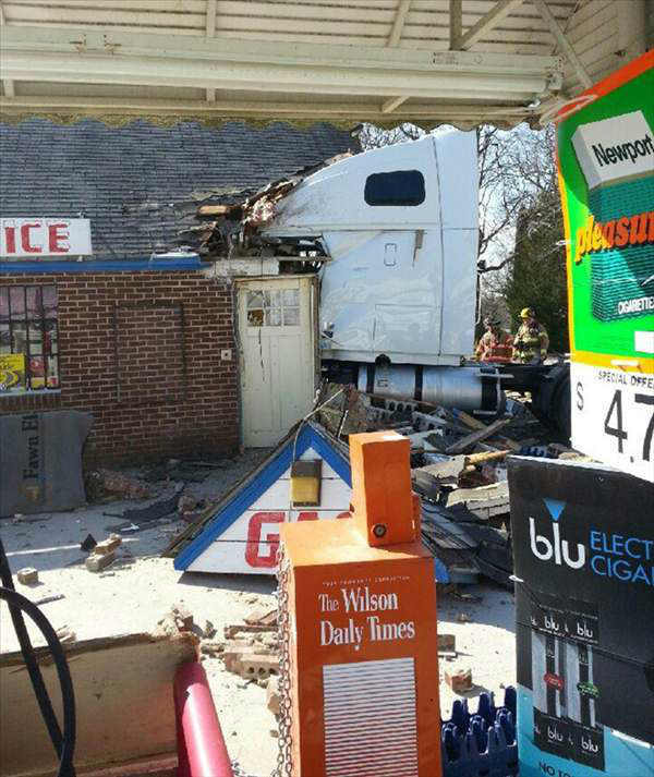 Investigators say a tractor-trailer truck ran off the road and slammed into a convenience store on U.S. 301 outside Lucama Friday around 9:30 a.m. No one in the store was hurt. The driver was taken to the Wilson Medical Center for treatment. <span class=meta>(WTVD Photo)</span>