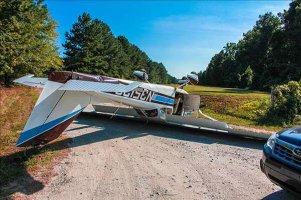 A small aircraft crashed along Highway 64 and west of the new toll Highway 540 just before 5 p.m. Friday evening.  <span class=meta>(WTVD Photo&#47; Mitch Lassiter)</span>