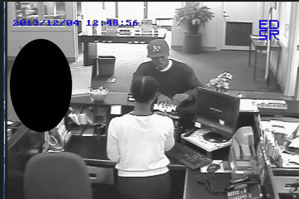 Investigators say the suspect robbed the First South Bank in the 700 block of Executive Place at about 12:45 p.m. Wednesday. <span class=meta>(Photo&#47;Courtesy: Fayetteville Police Dept.)</span>