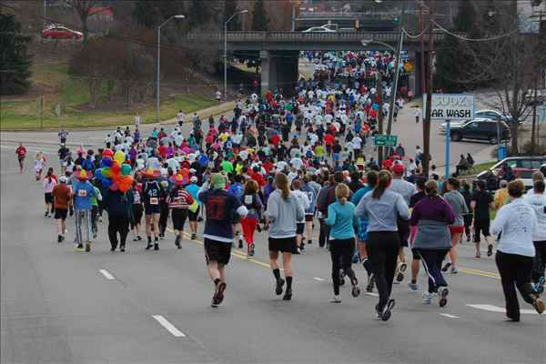 "<div class=""meta image-caption""><div class=""origin-logo origin-image ""><span></span></div><span class=""caption-text"">Over 7,700 people showed up for the five mile run and dozen doughnut challenge</span></div>"