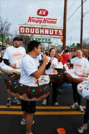 "<div class=""meta ""><span class=""caption-text "">Over 7,700 people showed up for the five mile run and dozen doughnut challenge</span></div>"