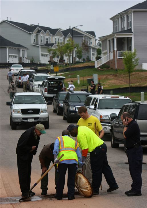 "<div class=""meta image-caption""><div class=""origin-logo origin-image ""><span></span></div><span class=""caption-text"">Police and SBI agents search a Durham neighborhood in April 2011. (WTVD Photo/ Julian Harrison)</span></div>"