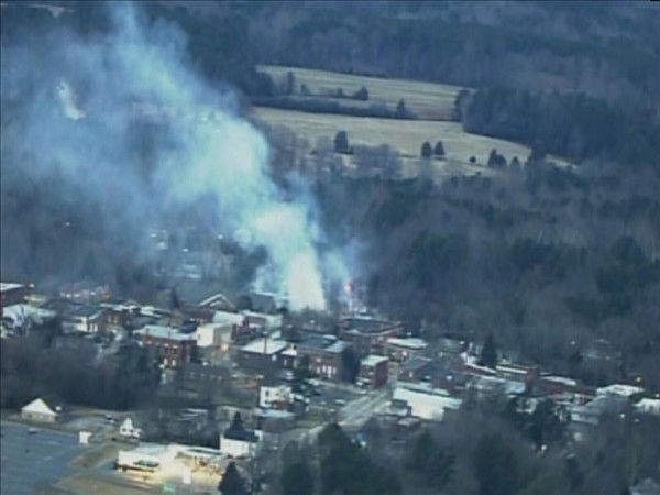 "<div class=""meta image-caption""><div class=""origin-logo origin-image ""><span></span></div><span class=""caption-text"">Pictures from Chopper 11 HD showed the Southern States Farm Supply building in Warrenton continued to smolder Thursday morning. (WTVD Photo/ Chopper 11 HD)</span></div>"