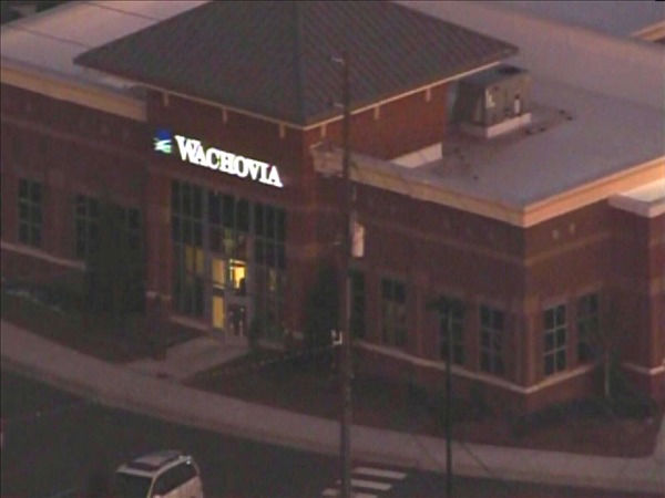The robber begins to exit with the hostage. <span class=meta>(WTVD Photo&#47; Chopper 11 HD)</span>