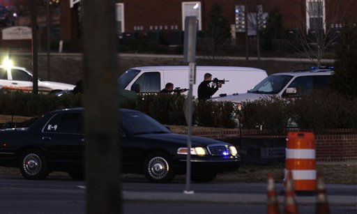 Police take aim at a suspect at a Wachovia Bank in Cary, N.C., where an armed man took people hostage Thursday, Feb. 10, 2011.  <span class=meta>(AP Photo&#47; Gerry Broome)</span>