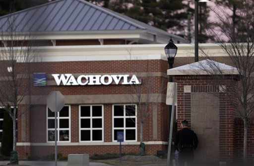 Police watch a Wachovia Bank in Cary, N.C., where an armed man took people hostage Thursday, Feb. 10, 2011.  <span class=meta>(AP Photo&#47; Gerry Broome)</span>