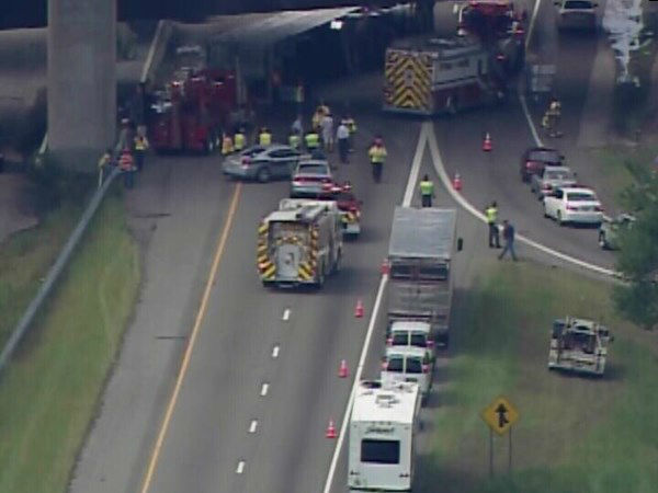 A tractor-trailer truck carrying a load of pigs flipped on its side along Interstate 95 just north of Fayetteville Wednesday morning. <span class=meta>(WTVD Photo)</span>