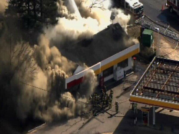 "<div class=""meta image-caption""><div class=""origin-logo origin-image ""><span></span></div><span class=""caption-text"">Firefighters battled a large blaze at a Raleigh gas station Friday afternoon. (WTVD Photo)</span></div>"