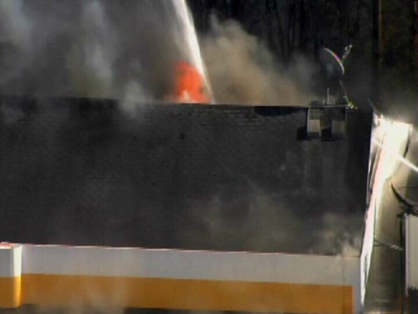 "<div class=""meta ""><span class=""caption-text "">Firefighters battled a large blaze at a Raleigh gas station Friday afternoon. (WTVD Photo)</span></div>"