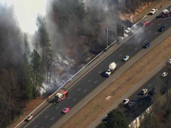 "<div class=""meta ""><span class=""caption-text "">A small woods fire burned along Interstate 40 west near the Wade Avenue exit after a crash involving several vehicles Friday afternoon. (WTVD Photo)</span></div>"
