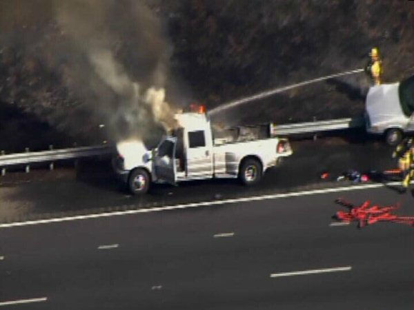 A small woods fire burned along Interstate 40 west near the Wade Avenue exit after a crash involving several vehicles Friday afternoon. <span class=meta>(WTVD Photo)</span>