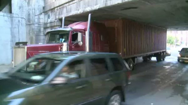 The bridge at South Roxboro and Pettigrew streets claimed another victim Monday. The bridge is only 11 foot 4 inches high, and often sees tall trucks get wedged underneath when drivers who don&#39;t know the area miss seeing the warning signs. <span class=meta>(WTVD Photo)</span>