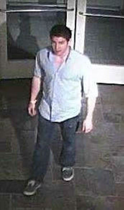 One of four people police are trying to identify from surveillance pictures. <span class=meta>(UNC Department of Public Safety Photo)</span>