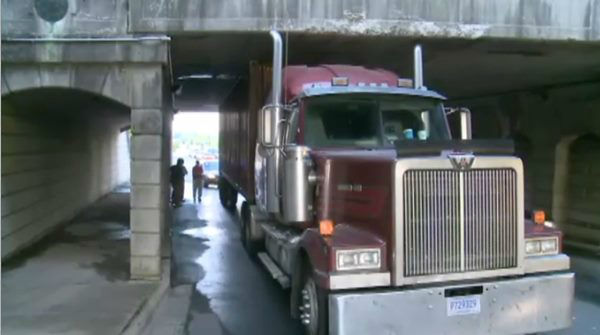 "<div class=""meta ""><span class=""caption-text "">The bridge at South Roxboro and Pettigrew streets claimed another victim Monday. The bridge is only 11 foot 4 inches high, and often sees tall trucks get wedged underneath when drivers who don't know the area miss seeing the warning signs. (WTVD Photo)</span></div>"
