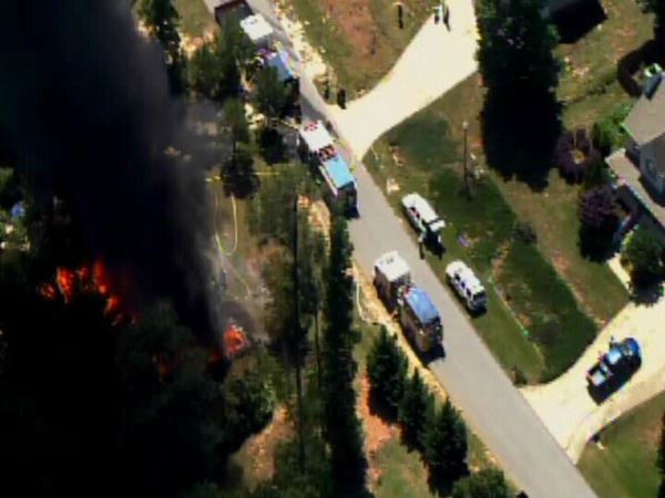 A huge fire ripped through a home in the 8400-block of Fawncrest Drive south of Garner and Lake Benson. <span class=meta>(WTVD Photo)</span>