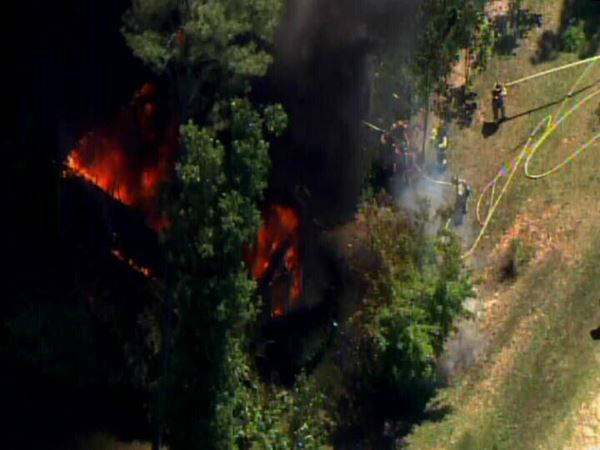 "<div class=""meta ""><span class=""caption-text "">A huge fire ripped through a home in the 8400-block of Fawncrest Drive south of Garner and Lake Benson. (WTVD Photo)</span></div>"