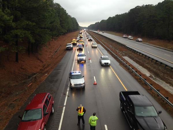 A truck went off the side of Highway 64 and flipped over. <span class=meta>(WTVD Photo&#47; Sheyenne Rodriguez)</span>