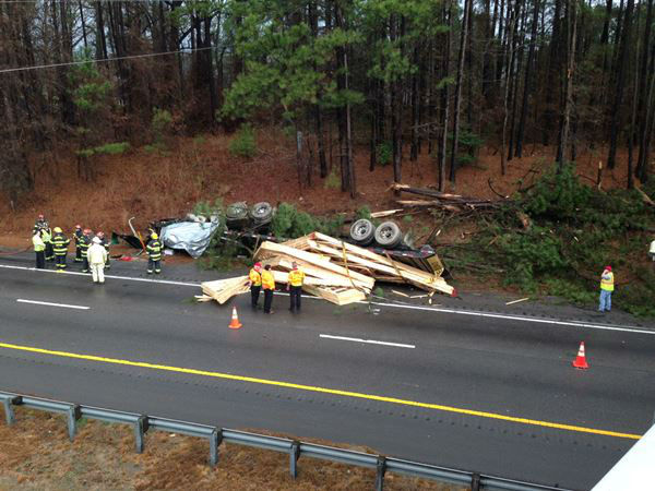 "<div class=""meta ""><span class=""caption-text "">A truck went off the side of Highway 64 and flipped over. (WTVD Photo/ Sheyenne Rodriguez)</span></div>"
