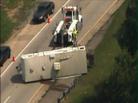 A travel trailer flipped on the ramp from I-40 westbound to I-85 southbound after blowing a tire. <span class=meta>(Photo&#47;WTVD Photo)</span>