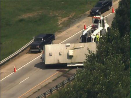 "<div class=""meta ""><span class=""caption-text "">A travel trailer flipped on the ramp from I-40 westbound to I-85 southbound after blowing a tire. (Photo/WTVD Photo)</span></div>"