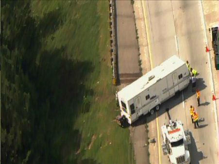 "<div class=""meta image-caption""><div class=""origin-logo origin-image ""><span></span></div><span class=""caption-text"">A travel trailer flipped on the ramp from I-40 westbound to I-85 southbound after blowing a tire. (Photo/WTVD Photo)</span></div>"